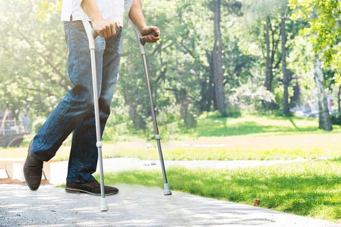 How do you transition from crutches to walking